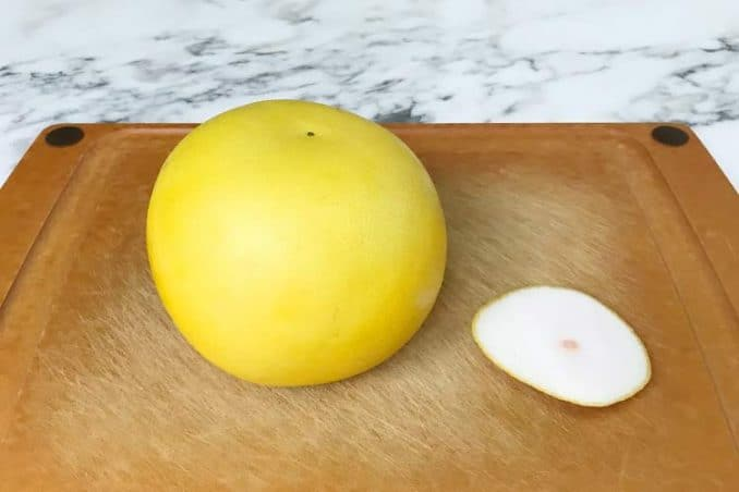 fruit with top cut off on cutting board