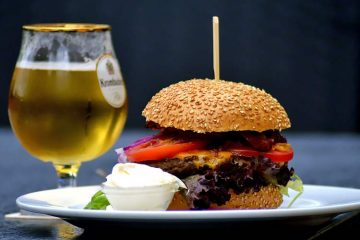 gourmet burger with tulip glass of fancy beer