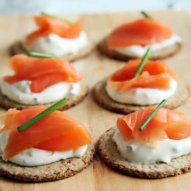 canapés made with crackers, salmon, and cream cheese