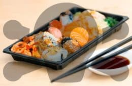 plastic tray of sushi with poison symbol
