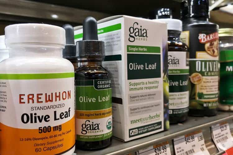 liquid and capsule olive leaf supplements on store shelf