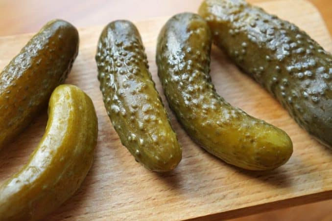 pickles on cutting board