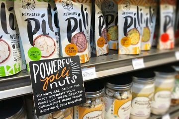 store sign listing health benefits of pili nuts