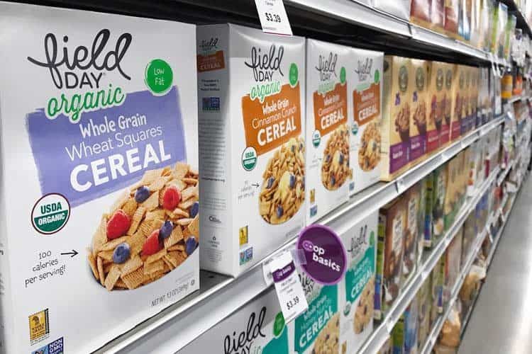 whole grain cereal boxes on supermarket shelf