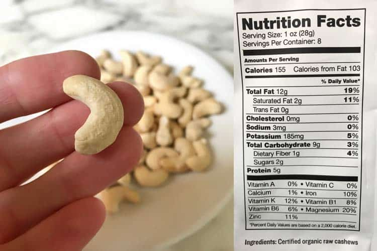 cashew nutrition facts label with photo of hand holding raw organic nut