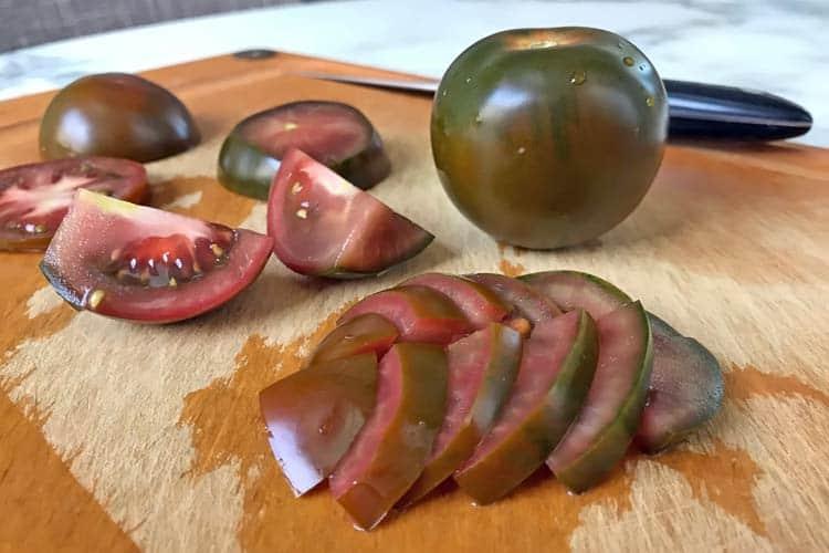 fresh Kumato tomato on cutting board, what inside looks like