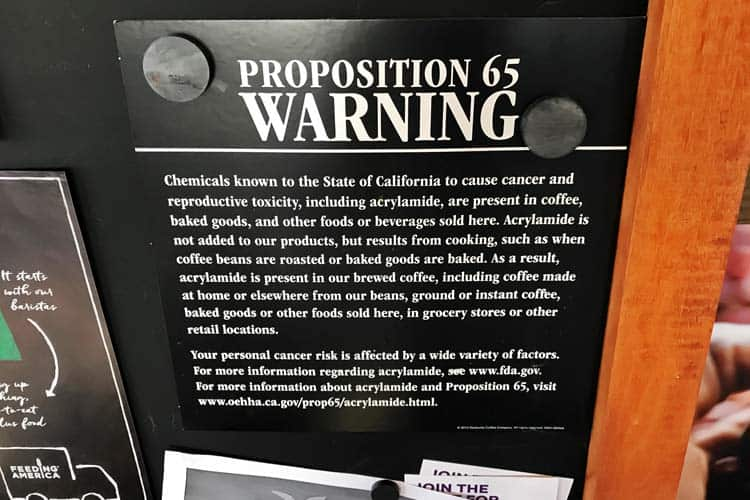 Starbucks Prop 65 warning sign for coffee acrylamide and cancer