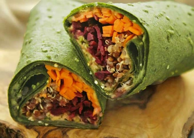 raw wrap filled with veggies and quinoa