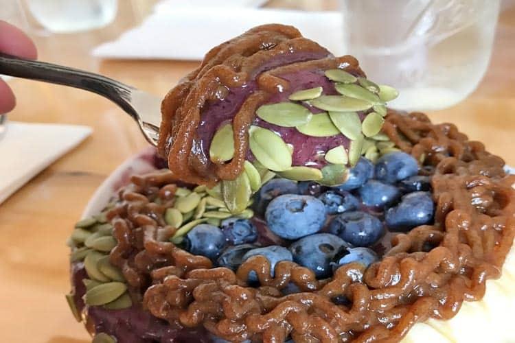 raw organic date paste on acai bowl