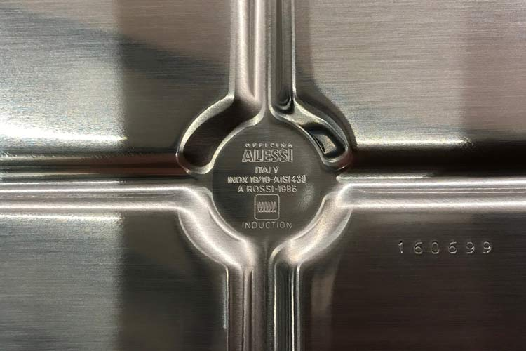 bottom of Alessi stainless steel kettle with induction symbol