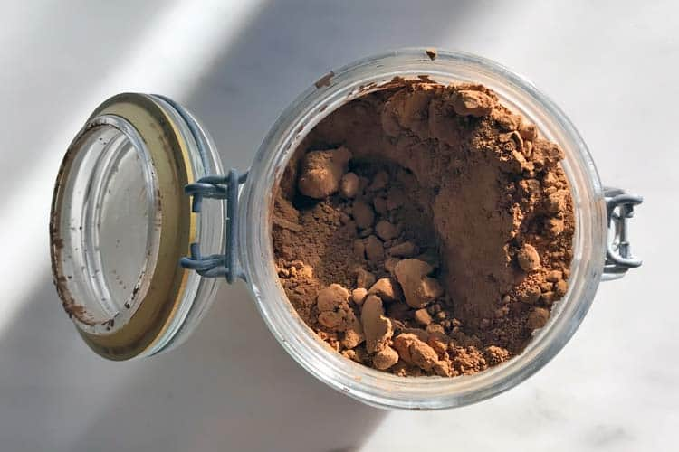 raw organic cacao powder in glass jar