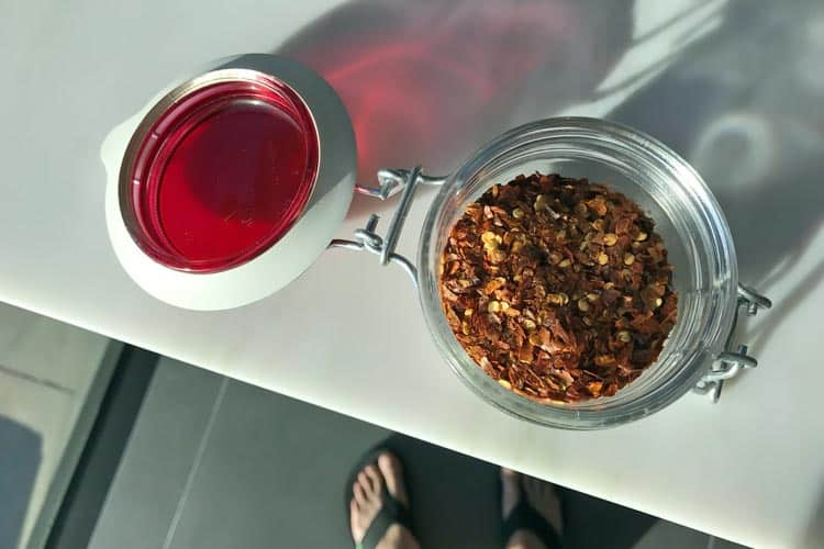 hot chili pepper flakes in small red Fido jar