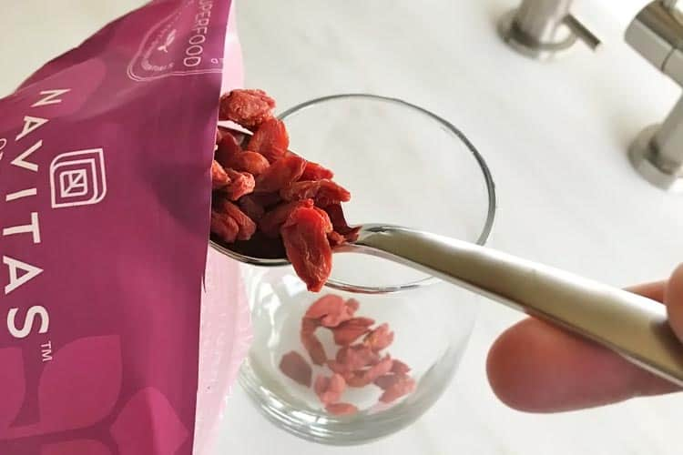scooping tablespoon of dried berries