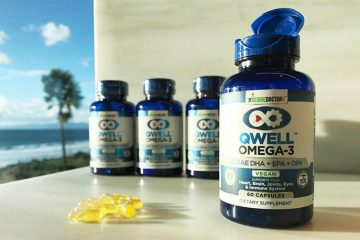 bottles of Qwell omega 3 veggie capsules on countertop