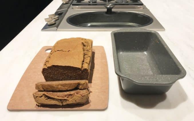 gluten free bread sliced next to pan