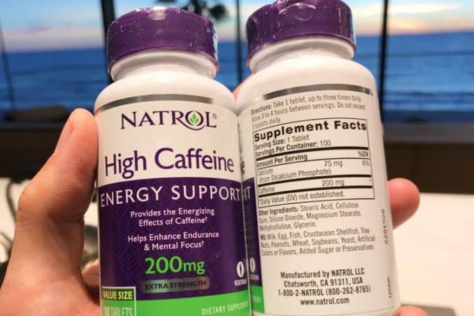 Natural caffeine tablets bottle with dosage instructions