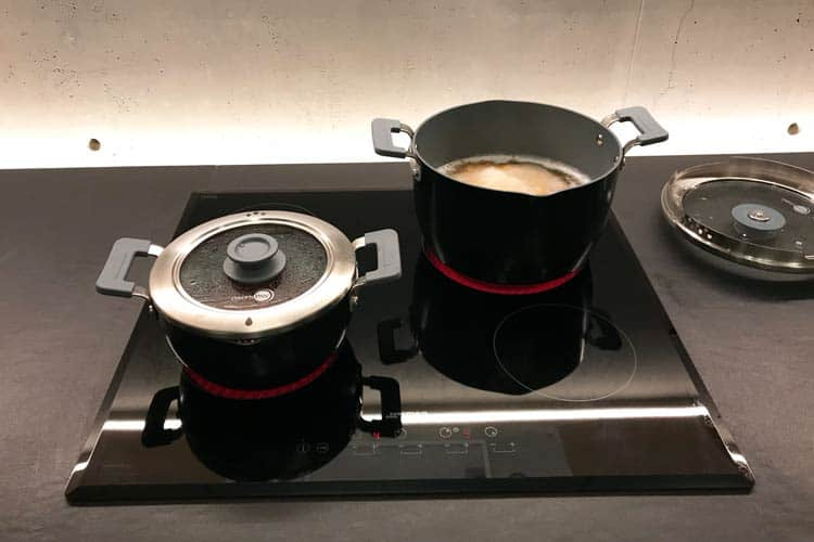cooking with Levels sauce pan and stock pot on stovetop