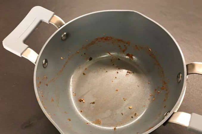 GreenPan Levels Essentials 3.2QT covered saucepan, dirty after making spaghetti sauce