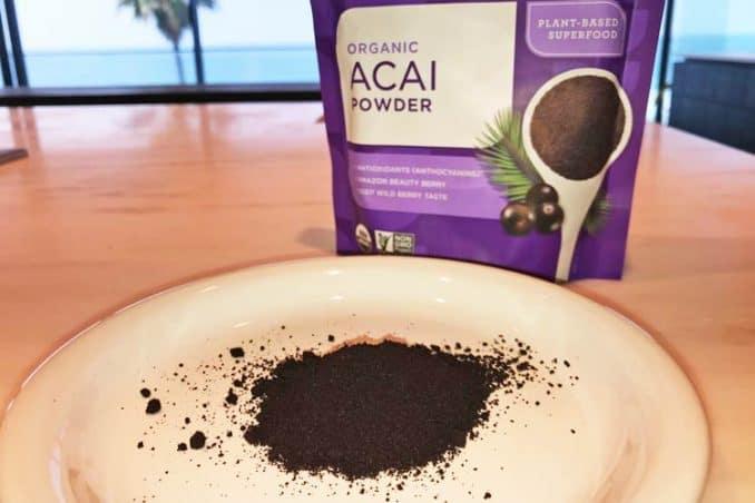Navitas Organics freeze-dried acai powder on plate next to 8 oz bag