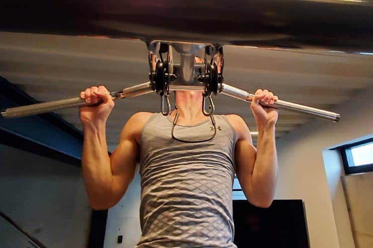 doing pull-ups wearing Aircom wireless headset